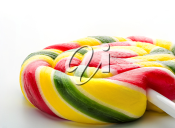 Colorful sweet lollipop closeup isolated on white background
