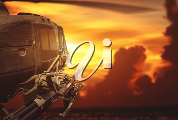 Military helicopter flying on sunset background. Military, army and war concept.