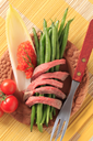 Strips of roast beef with green beans