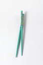 A pair of blue chopsticks with floral pattern