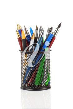 pens in holder basket isolated on white background