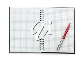 pen on checked notebook isolated at white background