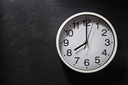 wall clock at black background texture