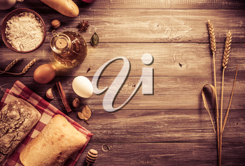 bread and bakery products on wood background