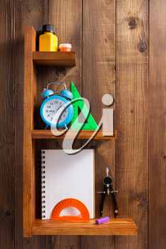 school supplies and tools at wall wooden shelf