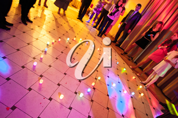 Candles are placed on a floor in the form of heart.