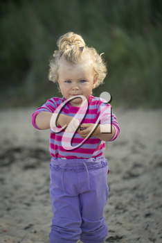 little girl walking by the sea. summer vacation by the ocean