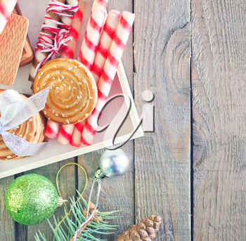 christmas background, christmas cookies and decoration on wooden boards