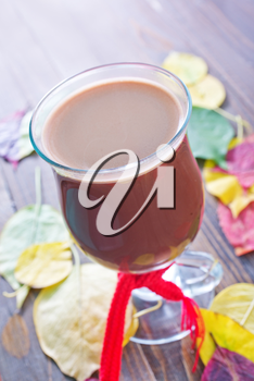 cocoa drink in cup and on a table