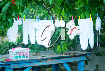 baby clothes in garden, clear baby clothes
