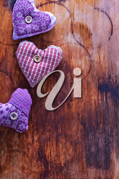 Love hearts on vintage wood, violet hearts