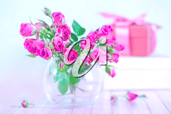 flowers in vase and on a table