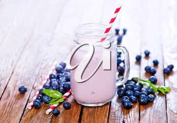 blueberry yogurt in glass and on a table