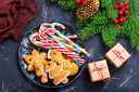cookies and candycane on a table, christmas background