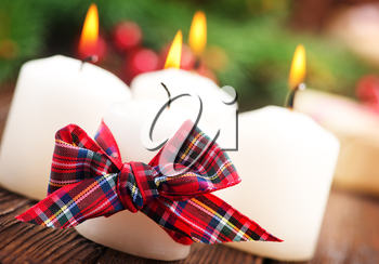 candles with ribbon on a table, christmas decoration