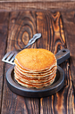 sweet pancakes on plate and on a table