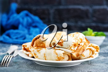 pancakes on plate and on a table