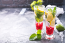 cold lemonad with raspberry in the glasses
