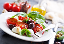 caprese salad on plate and on a table
