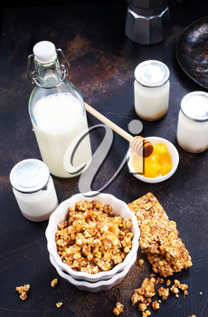 sweet granola with nuts and honey in the bowl