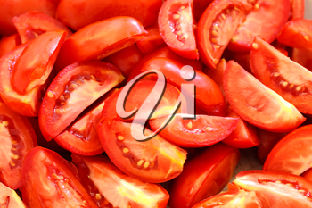 Background of the pieces of ripe chopped tomatoes