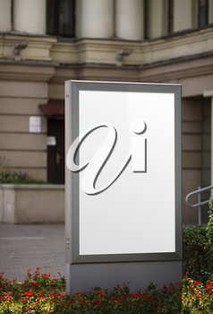 Blank vertical billboard. Clipping path. Shallow depth of field.