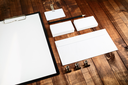 Photo of blank stationery set. Blank corporate identity template for branding identity for designers. Mockup for ID. Letterhead, business cards, badge, envelope and pencil.