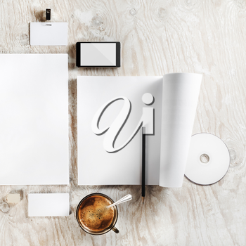 Photo of blank stationery set. Mock up for branding identity. Corporate identity template on light wooden table background. Blank objects for placing your design. Top view.