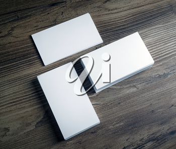 Three piles of blank business cards on wooden table background. Mockup template for branding identity. Top view.