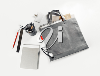 Blank gray shopping bag and stationery on paper background. Responsive design mock up.