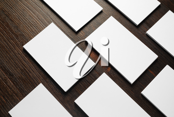 Blank white business cards on wooden background. Mockup for branding identity. Responsive design template.