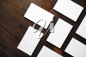 Blank white business cards mock-up on wooden background.Copy space for text. Flat lay.
