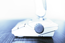 Blueish retro arcade joystick bokeh background