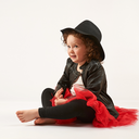 Little girl with black hat sitting and dreams
