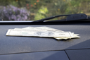 Dollars on a car dashboard under the windshield. American Money.