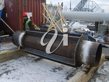 Sakhalin, Russia - 12 November 2014: Welding of a dyuker in a cartridge. Strengthening of a design of the pipeline.