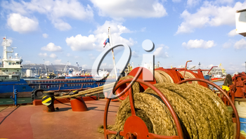 Mechanisms of tension control ropes. Winches. Equipment on the deck of a cargo ship or port.