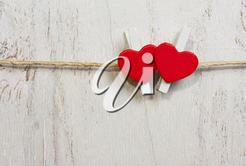 Two lovely red hearts. On old white wood background.