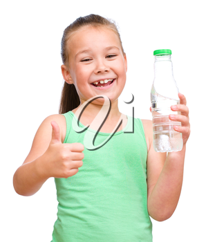 Cute little girl drinks water from a plastic bottle, isolated over white