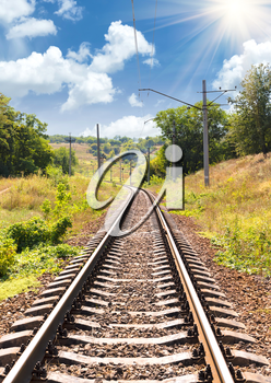 Concept of tourism and travel. The railway passing through a beautiful landscape in the summer