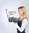 Business woman holding a laptop and 2016. business planning and concept