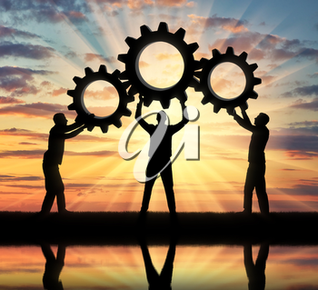 Silhouette of the three men holding the gears put them together in one gear. The concept of mutual aid