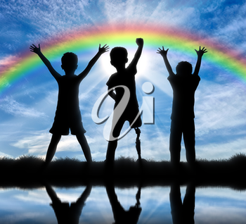 Children with disabilities and friendship with them concept. Happy disabled boy with a prosthetic leg standing among their friends, near the river and the rainbow