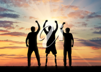 People with disabilities in society concept. Happy disabled man with a prosthetic leg standing and his friends at sunset