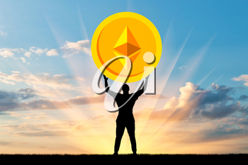 Silhouette of a man holding a coin ethereum against the sky. The concept of the future for crypto currency