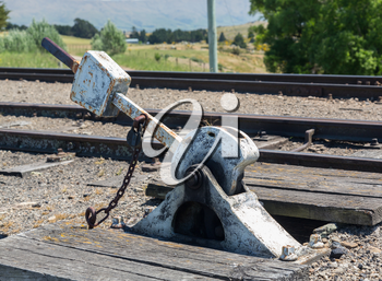 Heavy duty points lever by railway track of Taieri Gorge tourist railway