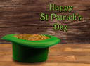 Treasure of pure gold coins inside a green velvet hat on wooden table to celebrate luck on March 17th. Text included saying Happy St Patrick's Day