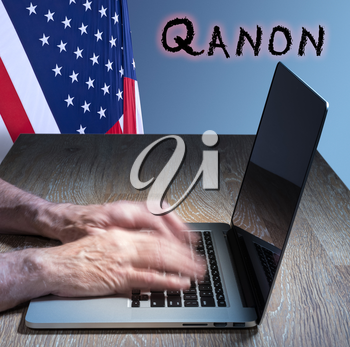 Senior caucasian man types on computer. Concept background illustration for QAnon or Q Anon, a deep state conspiracy theory