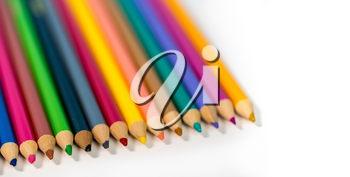 Row of colorful childs school drawing pencils against a white background