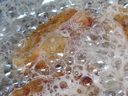 hot and boiling food oil in pan while fried chicken